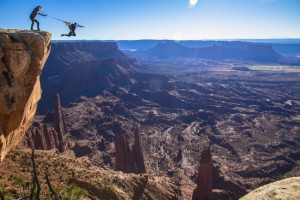 Miles Daisher takes a leap of faith while Andy Lewis pulls his B.A.S.E. rig at the Fisher Towers near Moab, UT, USA on 28 October, 2014. // Clark Fyans / Red Bull Content Pool // VIN: SI201412130003 // Usage for editorial use only // Please go to www.redbullcontentpool.com for further informations. //